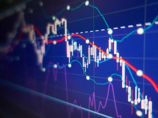 Colorful digital display showing stock market charts indicating losses.