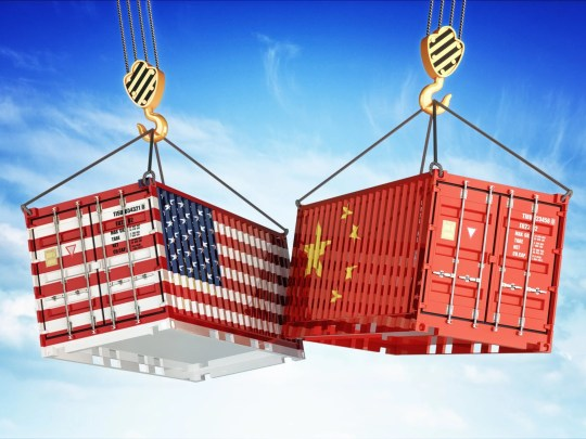 Shipping containers painted to resemble U.S. and China flags.