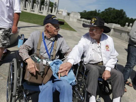 WWII Army veteran Fred Plichta, 88 of Monroe, MI, right