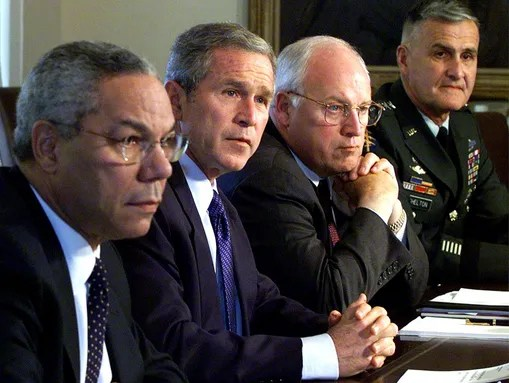 President George W. Bush sits with his National Security