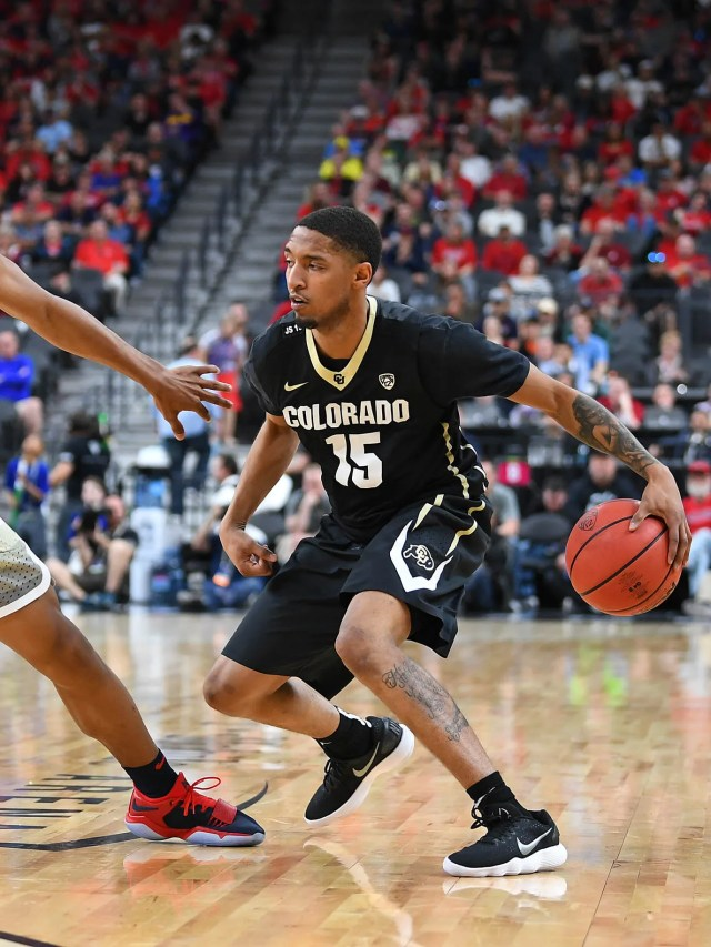 Colorado Buffaloes guard Dominique Collier (15) dribbles against the defense of Arizona Wildcats guard Allonzo Trier (35) during a quarterfinals match of the Pac-12 Tournament at T-Mobile Arena.
