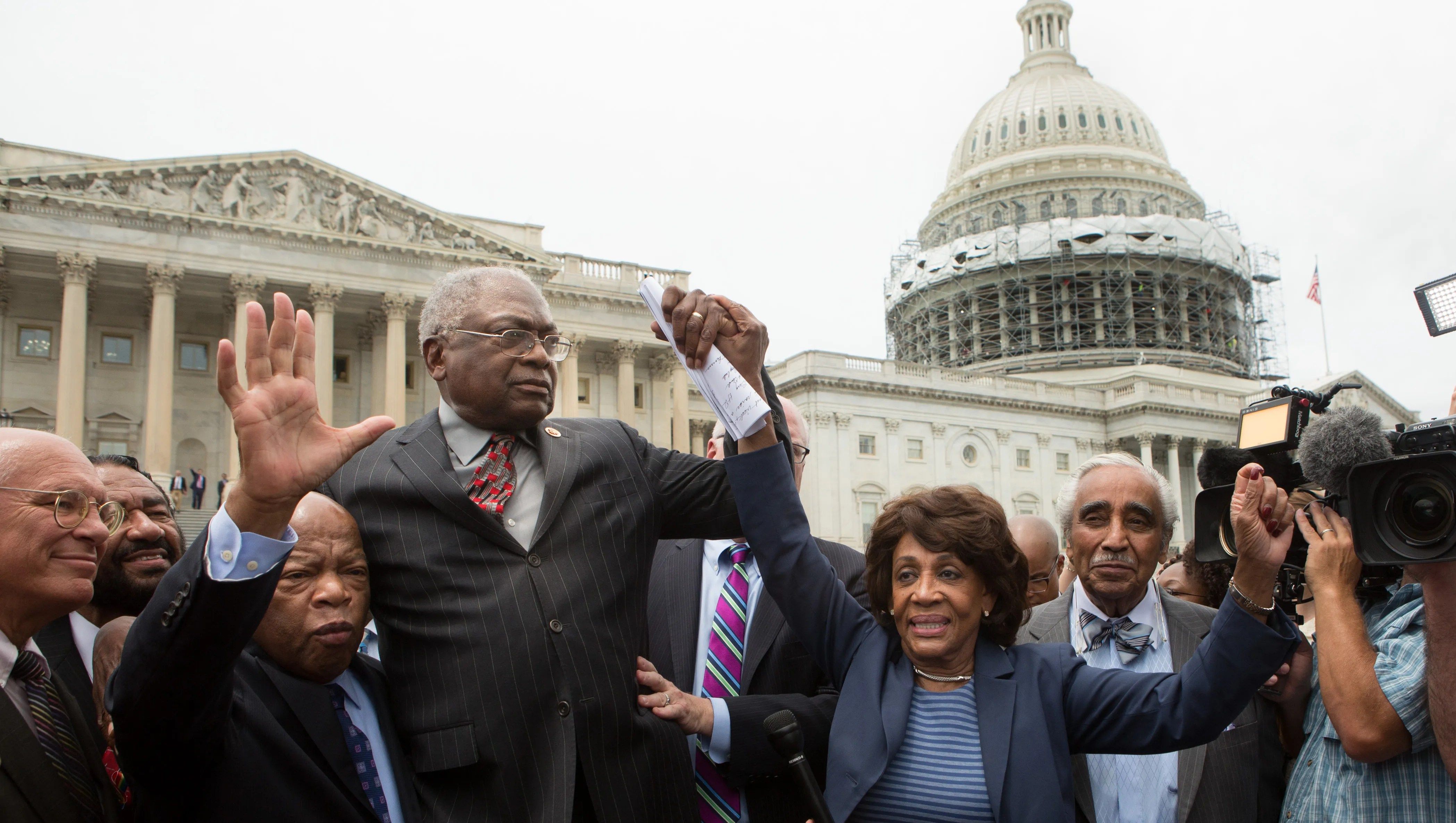 Reps. John Lewis, James Clyburn, Maxine Waters and Charles Rangel speak with supporters outside the Capitol on June 23, 2016.