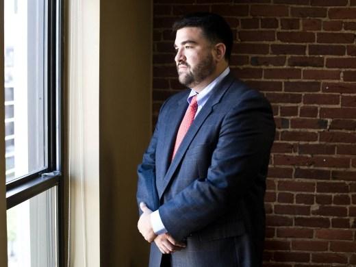 Danny Alvarez poses for a portrait in his office building