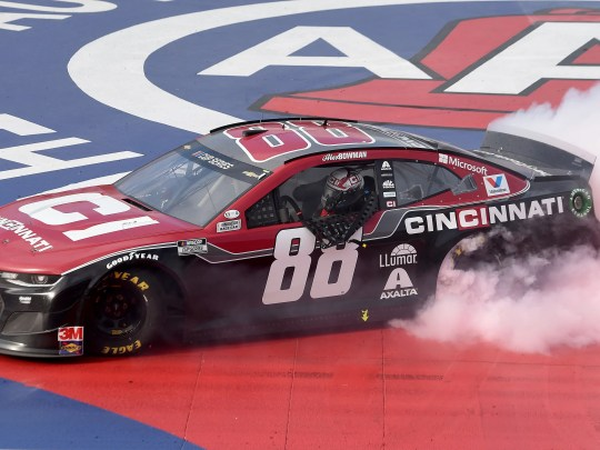 Alex Bowman celebrates with a burnout after winning a NASCAR Cup Series auto race Sunday, March 1, 2020 in Fontana, Calif. (AP Photo/Will Lester)