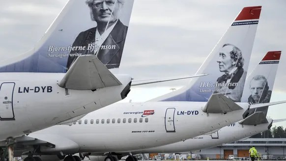 The tails of low-cost carrier Norwegian Air are seen