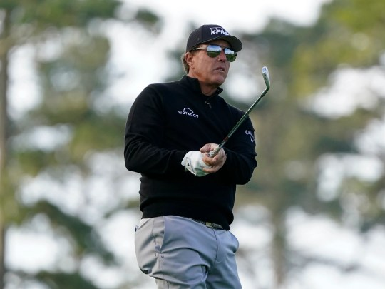 Phil Mickelson follows his approach shot to the 10th green of the Spyglass Hill Golf Course during the first round of the AT&T Pebble Beach Pro-Am golf tournament, Thursday, Feb. 11, 2021, in Pebble Beach, Calif. (AP Photo/Eric Risberg)