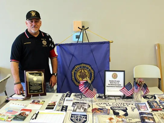 Don Bailey, Jr. mans the booth for American Legion
