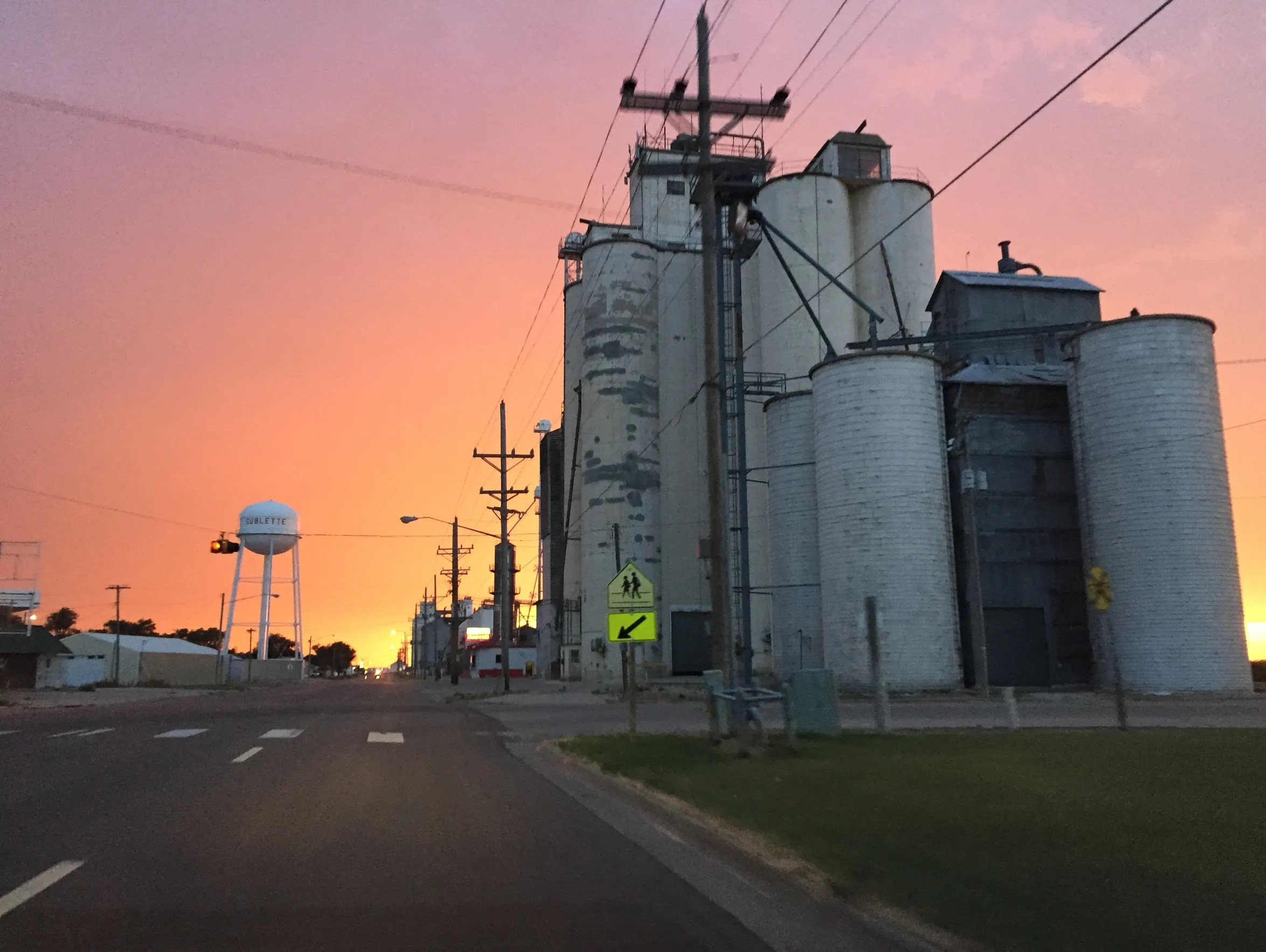Grain elevators tower over the street in Sublette,