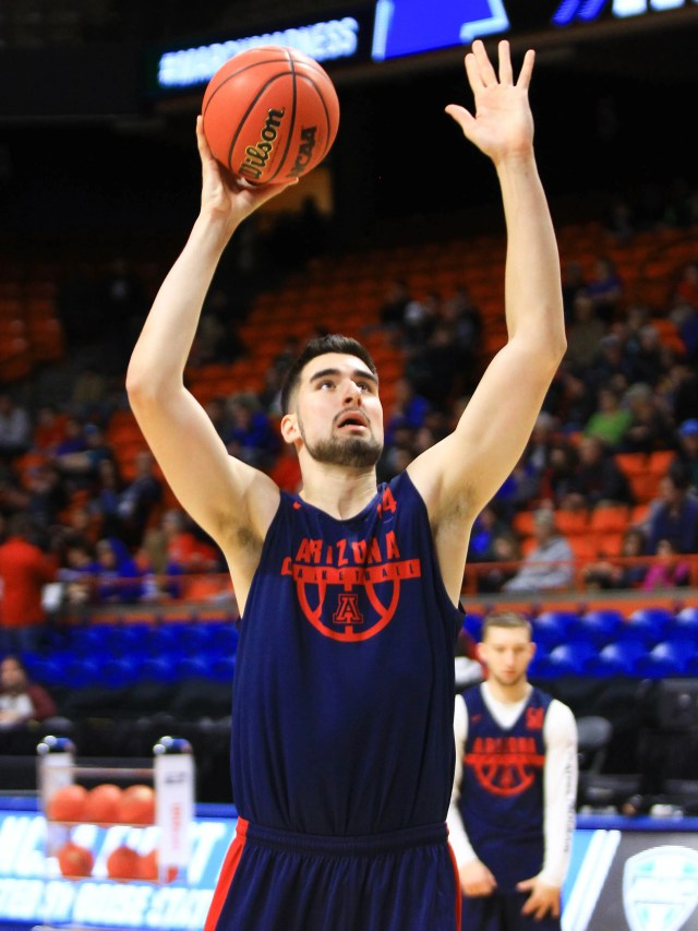 Mar 14, 2018: Arizona Wildcats center Dusan Ristic (14) shoots during the practice day before the first round of the 2018 NCAA Tournament at Taco Bell Arena.