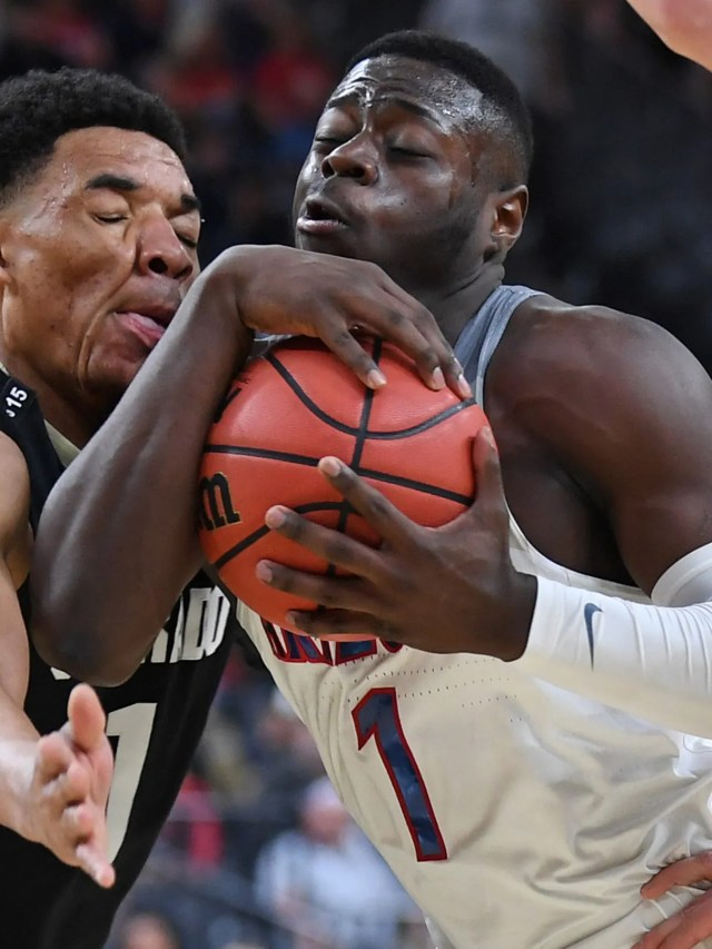 Mar 8, 2018; Las Vegas, NV, USA; Arizona Wildcats guard Rawle Alkins (1) protects the ball as he drives past Colorado Buffaloes guard Tyler Bey (1) during a quarterfinals match of the Pac-12 Tournament at T-Mobile Arena. Mandatory Credit: Stephen R. Sylvanie-USA TODAY Sports