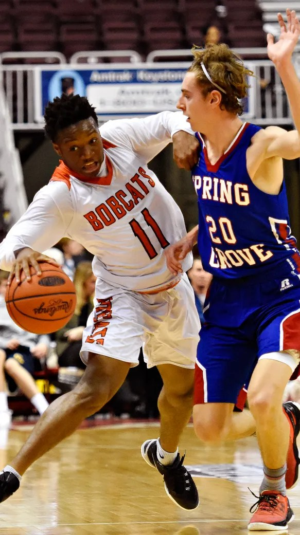 Northeastern's Fred Mulbah drives against Spring Grove's