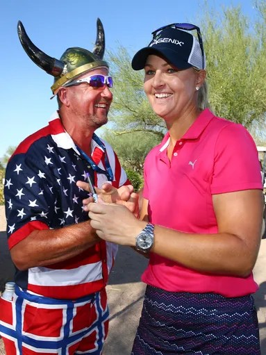 Anna Nordqvist is congratulated by a fan after shooting