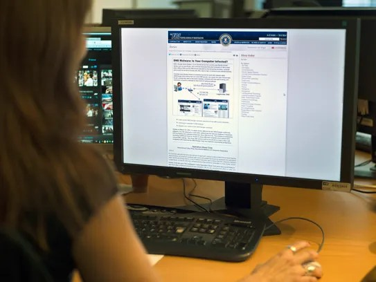 A woman looks at the FBI internet site page dedicated