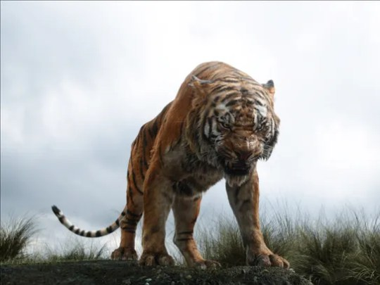 In this image released by Disney, Shere Khan the tiger,