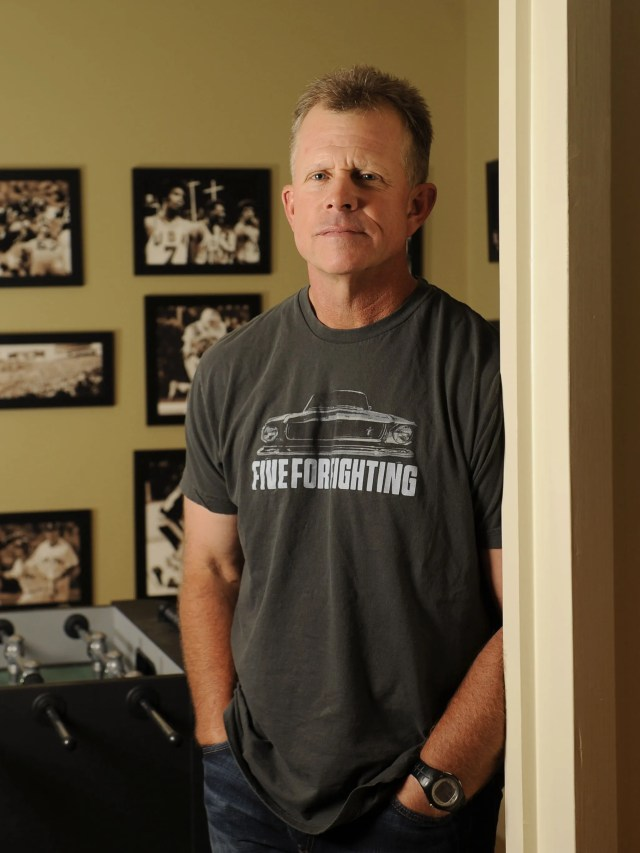 Vanderbilt University baseball coach Tim Corbin stands near a wall of photographs, each holding meaning to him, at his home Tuesday June 12, 2012 in Nashville, TN.