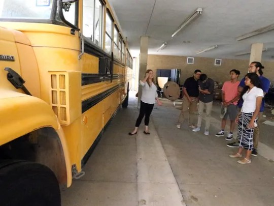 Students in the Bowie Business Academy show a donated