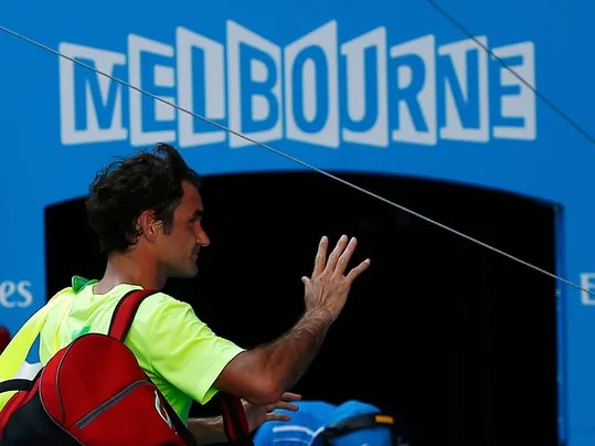 Federer waves to crowd as he leaves