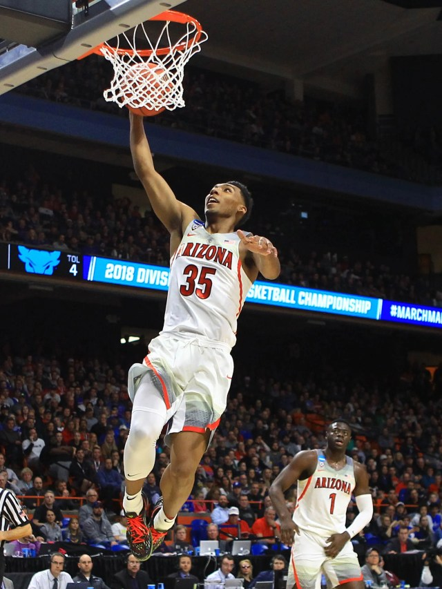 Mar 15, 2018; Boise, ID, USA; Arizona Wildcats guard Allonzo Trier (35) shoots as Buffalo Bulls guard Davonta Jordan (4) looks on in the first half during the first round of the 2018 NCAA Tournament at Taco Bell Arena. Mandatory Credit: Brian Losness-USA TODAY Sports