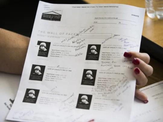 Sharon Johnston looks over her notes on Vietnam veterans