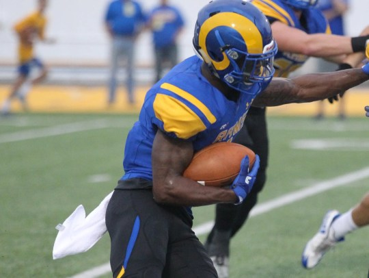 Angelo State University ran back Josh Stevens to fight for yards during the Rams' Lone Star Conference 40-14 win against Texas A & M-Kingsville at LeGrand Stadium at 1st Community Credit Union Field on Saturday, 30 September 2017.