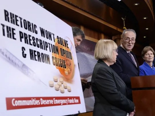 (From left to right:) Democratic Sens. Joe Manchin,