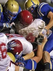 Franklin's Alex Ford (4) is stopped by Brentwood players