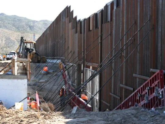 Work continues on an 18-foot high section of the border