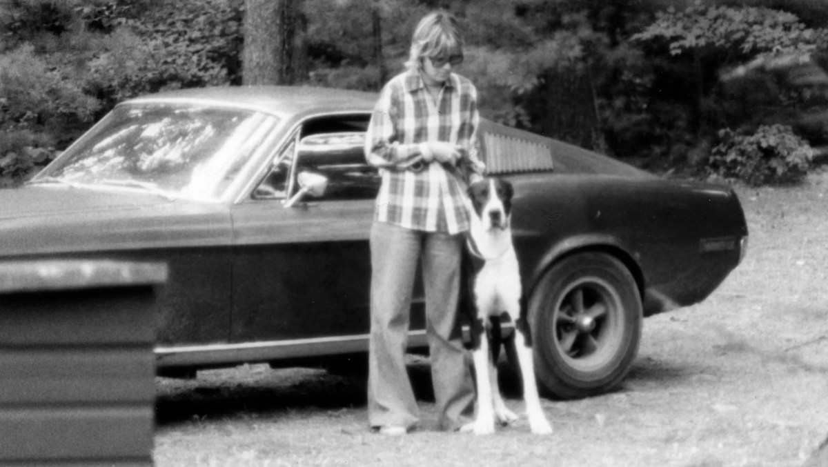 Robbie Kiernan with the Gatsby family dog next to her in 1977 with the original Mustang from the 1968 movie Bullitt.
