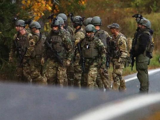 Pa. schools close in manhunt for accused cop killer