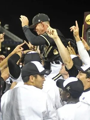 Vanderbilt coach Tim Corbin celebrates with his team after the Commodores won the national championship Wednesday.