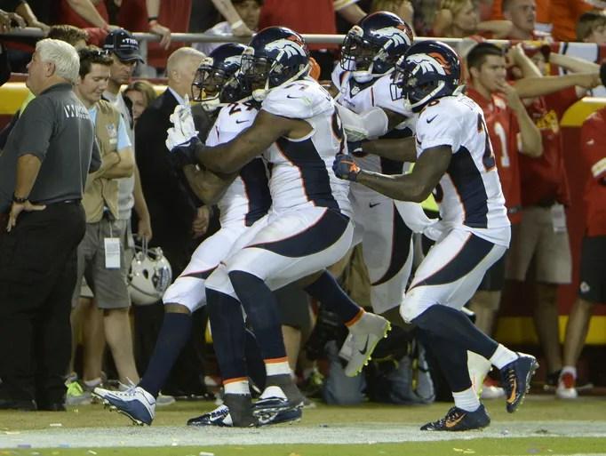 Denver Broncos cornerback Bradley Roby (29) is congratulated