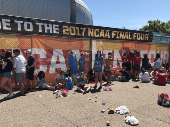 Gonzaga and North Carolina students line up outside