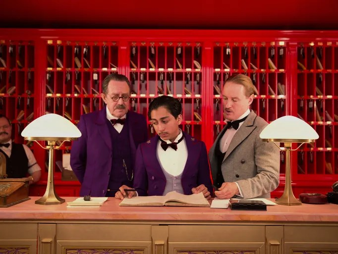 "This image released by Fox Searchlight shows Tom Wilkinson, Tony Revolori, center, and Owen Wilson, right,  in ""The Grand Budapest Hotel."""