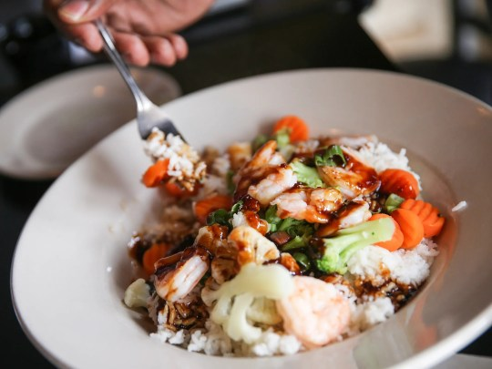 A grilled shrimp rice bowl served at the Stacked Pickle Franchises