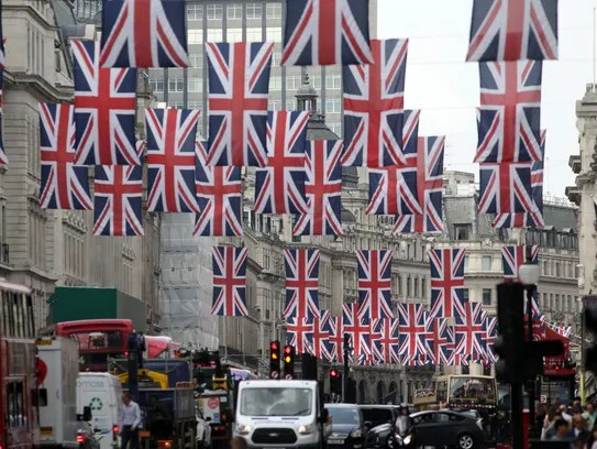 British Union flags hang above Regent Street in central