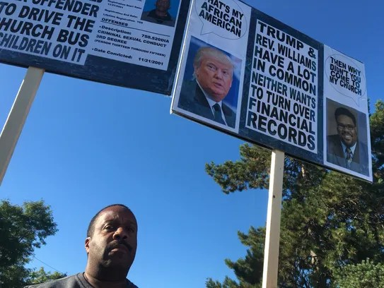 Keith Harris protests outside of the Great Faith Ministries