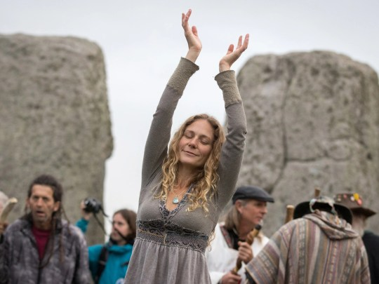 A woman dances during a fall equinox celebration at