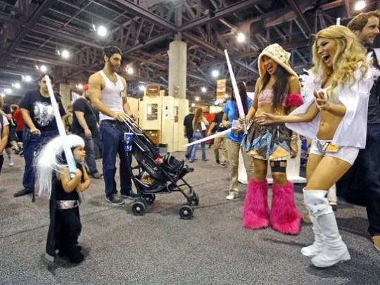 Anabelle Candiotti (left) has an impromptu lightsaber