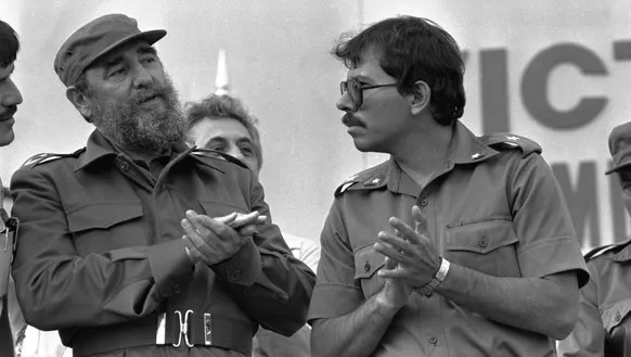 Cuban President Fidel Castro talks with Nicaraguan