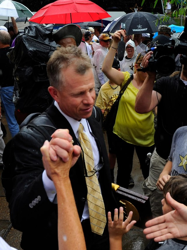 Vanderbilt baseball head coach Tim Corbin is greeted by fans as he arrives at Hawkins Field with the NCAA National Championship trophyduring the championship celebration.