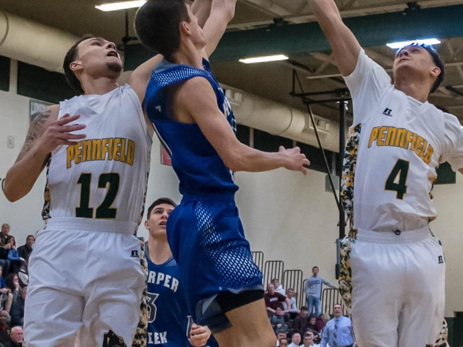 Pennfield's Steffen Kinne (12) and Deveaire Todd (4) go for the ...
