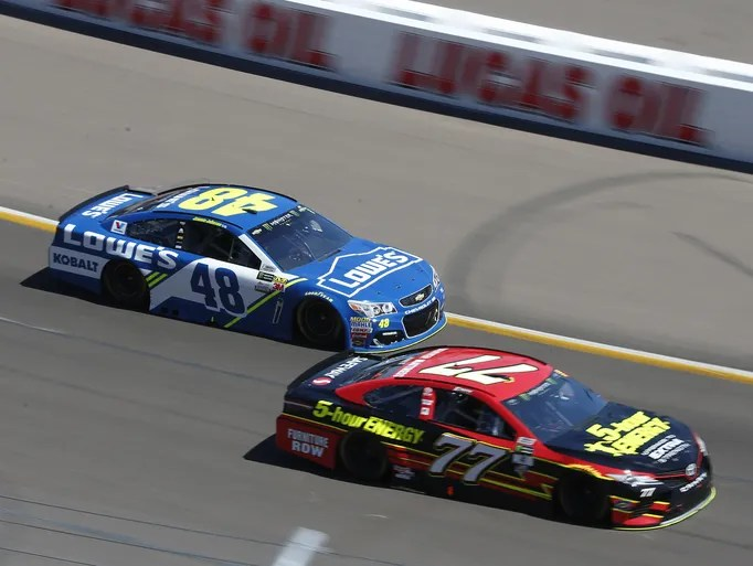 Jimmie Johnson (48) trails Erik Jones (77) in the 8th