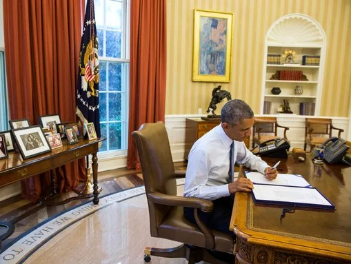 President Obama signs H.J. Res 124, which includes