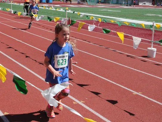 Lillian Duchateau, 6, finishes her run at the Awesome