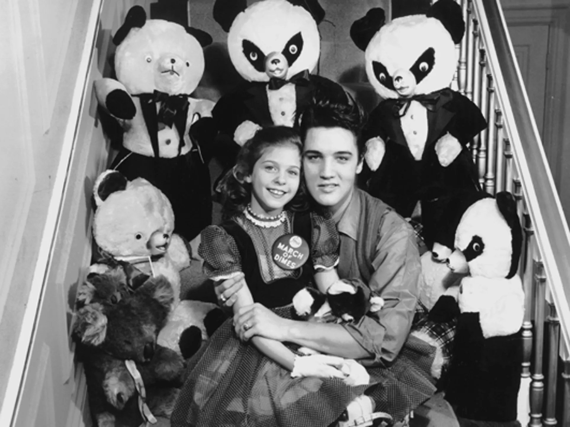 Eight-year-old Mary Kosloski had a date with Elvis Presley Jan. 8, 1958, and he kept her waiting for more than two hours. The Collierville girl, who was the national March of Dimes poster child in 1955, seemed to forgive all when Elvis appeared and told her: 'If you were 10 years older, honey, I wouldn't let you go.' The pair were photographed with teddy bears and pandas Elvis was sending to the National Foundation for Infantile Paralysis for auction during an upcoming fund drive.