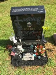 Loving mementos placed at the grave marker of Colin