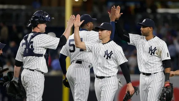 New York Yankees catcher Brian McCann (34) and relief