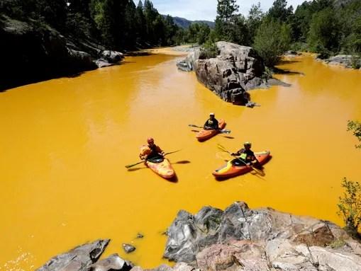 People kayak in the Animas River near Durango, Colo.,