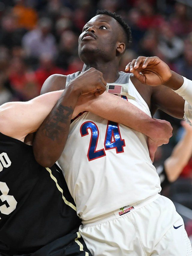 Mar 8, 2018; Las Vegas, NV, USA; Colorado Buffaloes forward Lucas Siewert (23) and Arizona Wildcats guard Emmanuel Akot (24) lock up as they look up for a rebound during a quarterfinal match of the Pac-12 Tournament at T-Mobile Arena. Mandatory Credit: Stephen R. Sylvanie-USA TODAY Sports