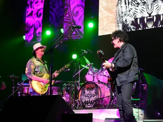 Carlos Santana and Neal Schon onstage during Santana